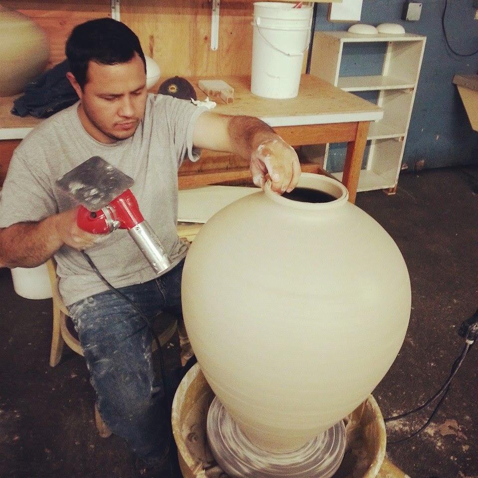 Eusebio Lozano Ceramics throwing it hard