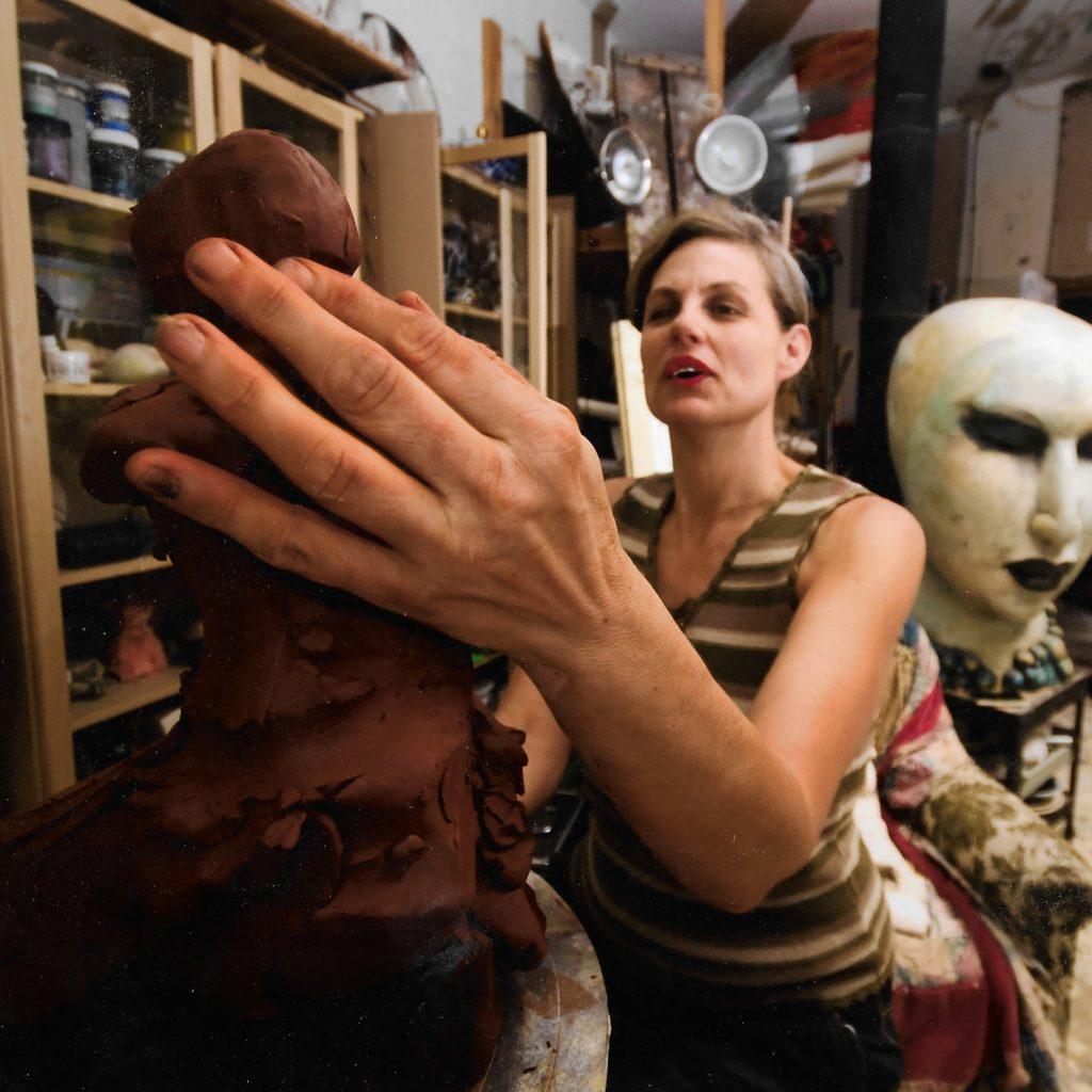 Michelle gregor in studio sculpting artist sculptor