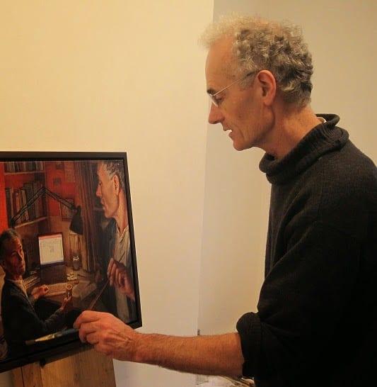 Julian Bell painting in studio